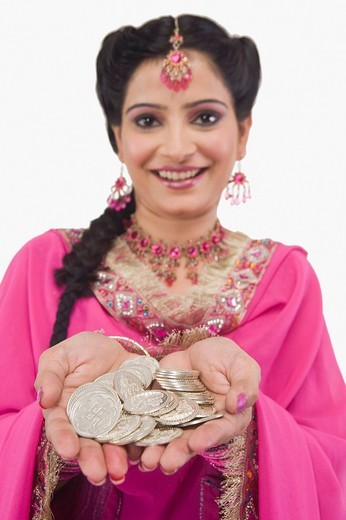 Portrait of a woman holding coins : Stock Photo