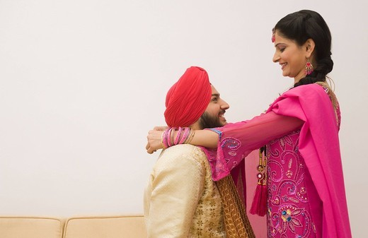Stock Photo: 1657R-37166 Sikh couple romancing