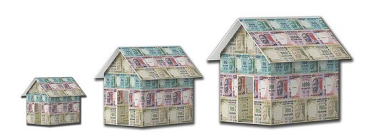Close_up of model homes made from rupees : Stock Photo