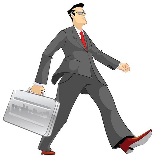 Businessman walking with a briefcase : Stock Photo