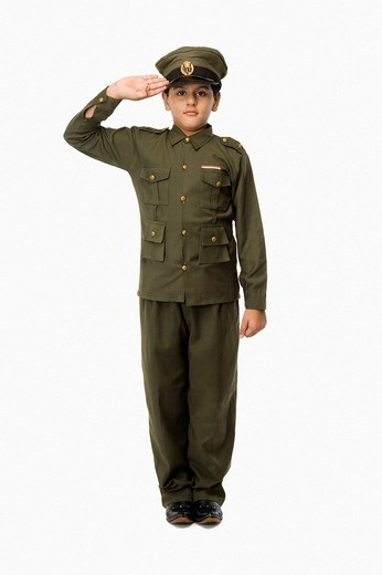 Portrait of a boy saluting in police uniform : Stock Photo