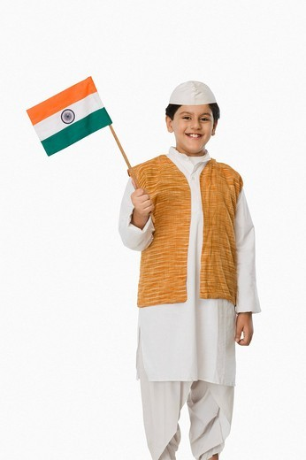 Boy in politician´s costume holding an Indian flag : Stock Photo