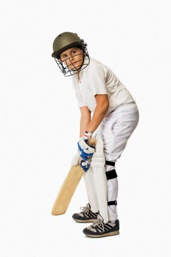 Boy playing cricket : Stock Photo