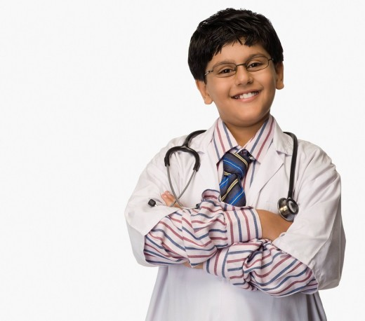 Boy smiling in a lab coat : Stock Photo