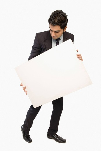 Close_up of a businessman showing a blank placard : Stock Photo