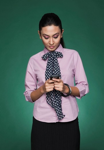Stock Photo: 1657R-38385 Close_up of a businesswoman text messaging on a mobile phone