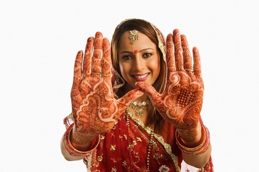 Portrait of a bride showing henna decorated palms : Stock Photo