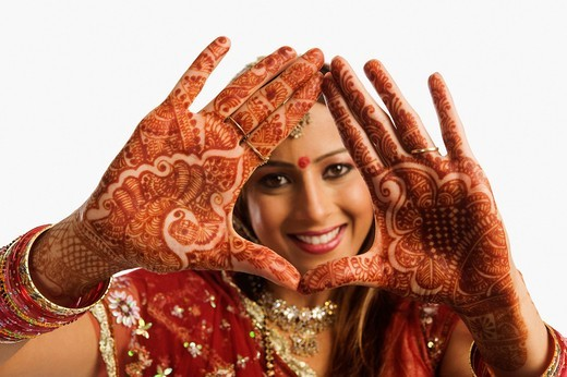 Stock Photo: 1657R-38643 Portrait of a bride showing henna decorated palms