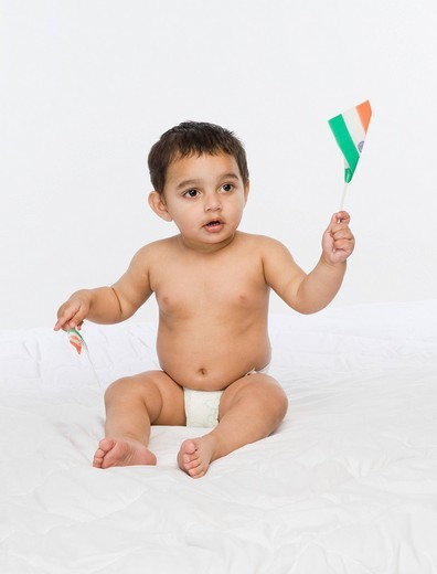 Baby boy holding an Indian flag : Stock Photo