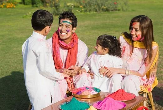 Stock Photo: 1657R-39334 Family celebrating Holi in a garden