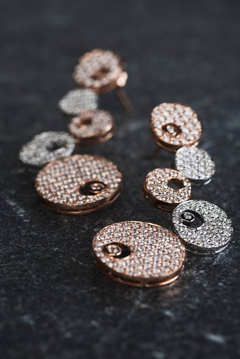 Close_up of a pair of earrings : Stock Photo