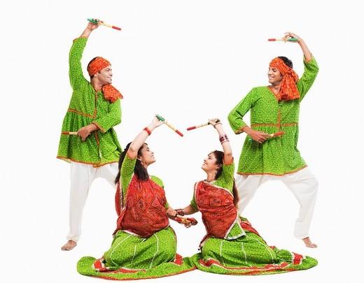 Men and women performing dandiya : Stock Photo