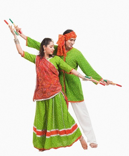 Couple performing dandiya : Stock Photo