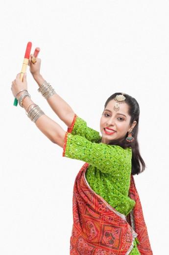 Portrait of a woman performing dandiya : Stock Photo