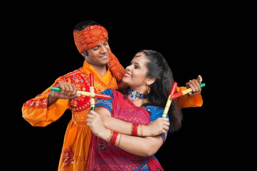 Couple performing dandiya : Stock Photo