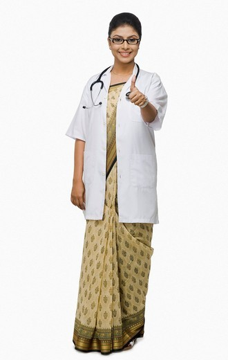 Stock Photo: 1657R-40013 Portrait of a female doctor showing thumbs up sign