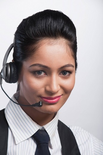 Stock Photo: 1657R-40381 Portrait of a female customer service representative wearing a headset