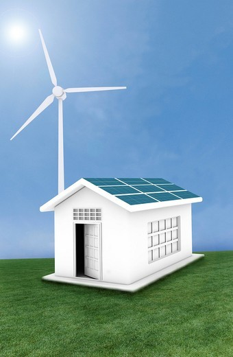 House powered with solar and wind energy : Stock Photo