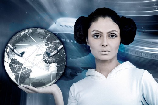Portrait of a woman holding a globe showing global route : Stock Photo