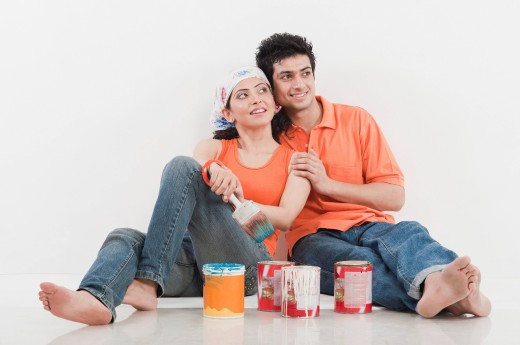 Couple with paint cans : Stock Photo