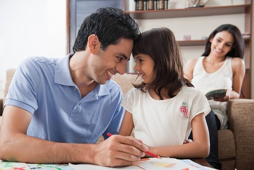 Stock Photo: 1657R-41484 Man assisting his daughter in drawing