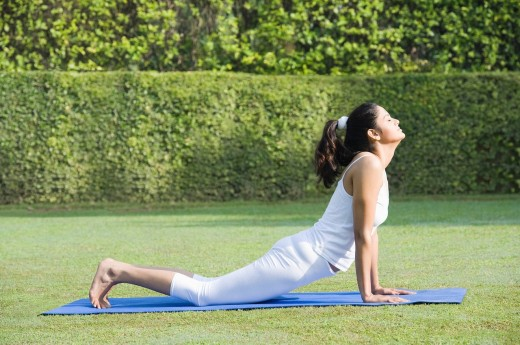Woman doing Surya Namaskar Sun Slautation : Stock Photo