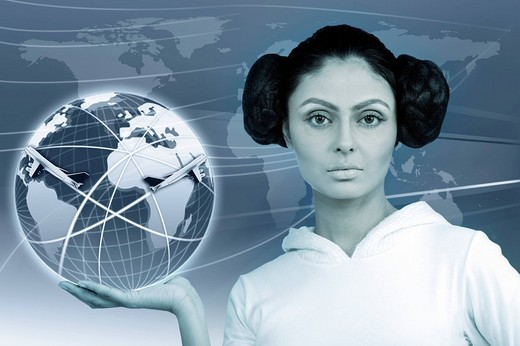 Portrait of a woman holding a globe showing air routes : Stock Photo