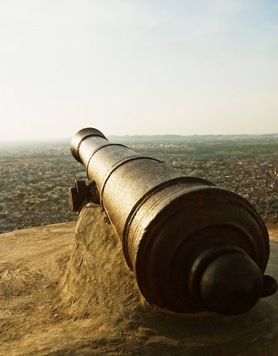 Cannon in a fort with cityscape, Nahargarh Fort, Jaipur, Rajasthan, India : Stock Photo