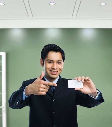 Businessman showing a blank business card : Stock Photo