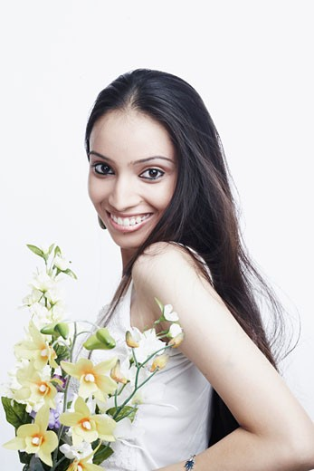 Portrait of a teenage girl holding a bunch of flowers : Stock Photo