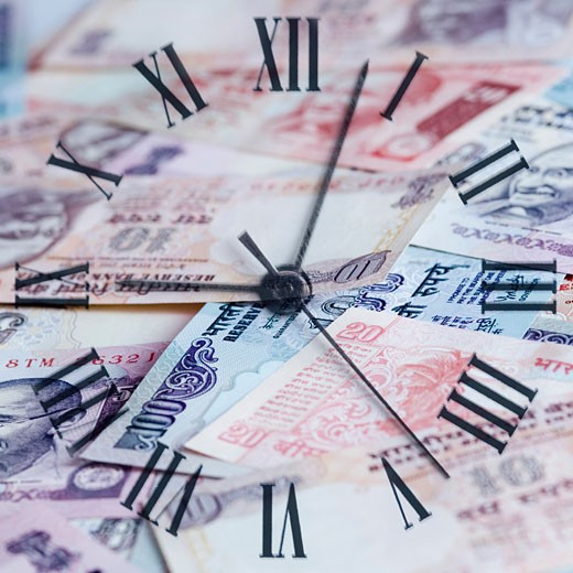 Stock Photo: 1657R-6687 High angle view of a clock on Indian banknotes