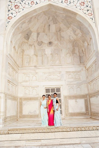 Stock Photo: 1657R-8055 Portrait of three young women standing in a mausoleum, Taj Mahal, Agra, Uttar Pradesh, India