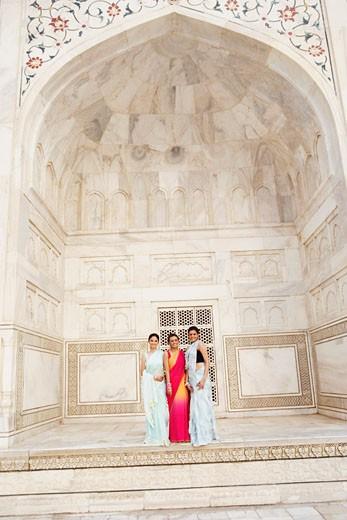 Portrait of three young women standing in a mausoleum, Taj Mahal, Agra, Uttar Pradesh, India : Stock Photo