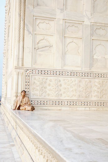 Young man sitting in a mausoleum, Taj Mahal, Agra, Uttar Pradesh, India : Stock Photo