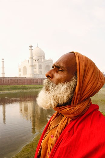 Close-up of a priest meditating on the riverbank with his eyes closed, Taj Mahal, Agra, Uttar Pradesh, India : Stock Photo