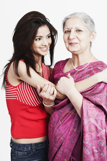Portrait of a mature woman with her granddaughter : Stock Photo