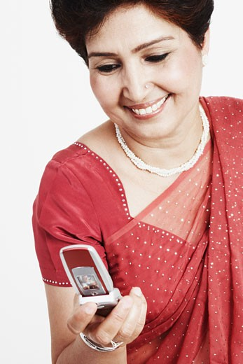 Close-up of a mature woman holding a mobile phone : Stock Photo