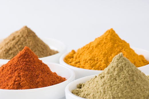 Close-up of four bowls of spices : Stock Photo