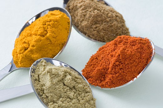 Stock Photo: 1657R-9206 Close-up of spices in four spoons