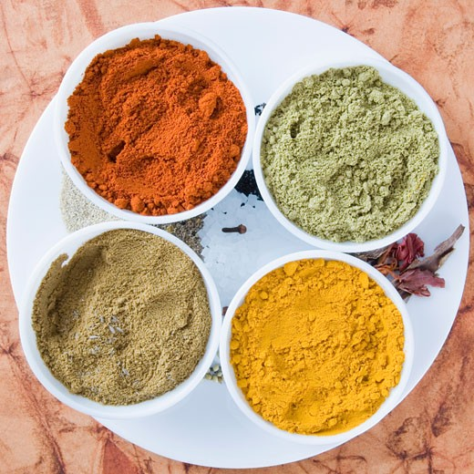 High angle view of spices in four bowls : Stock Photo