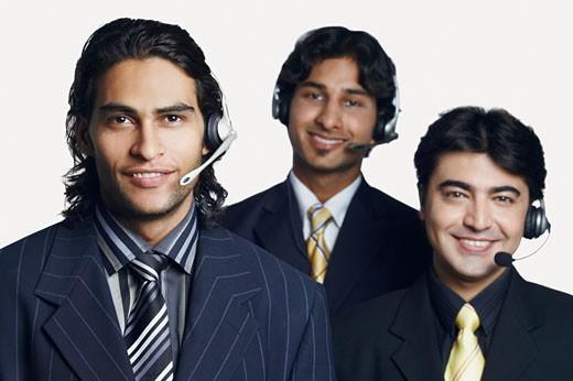 Stock Photo: 1657R-9803 Portrait of three male customer service representatives smiling