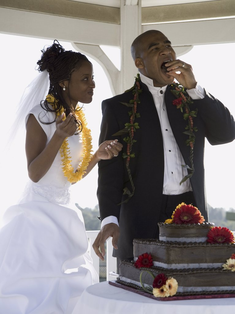 Stock Photo: 1660R-10148 Bride and groom eating their wedding cake
