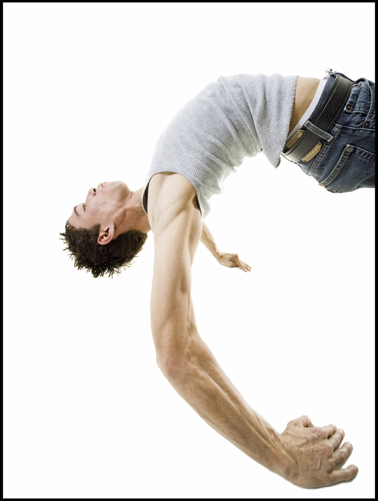 Stock Photo: 1660R-10260 Profile of a young man break dancing