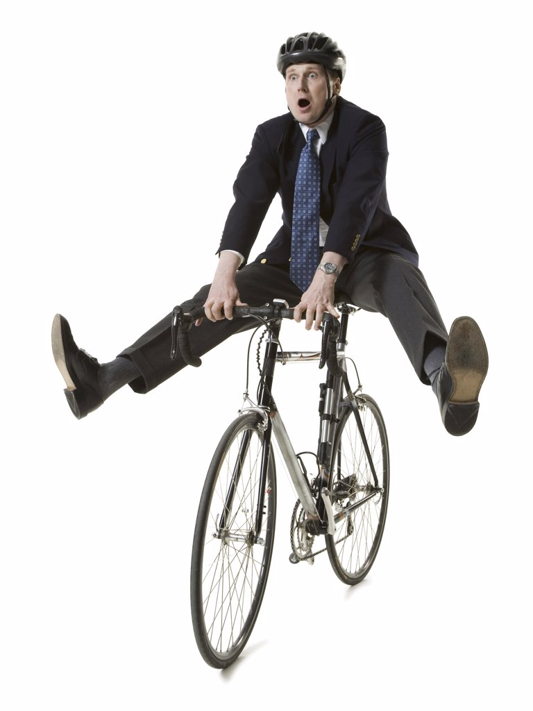 Stock Photo: 1660R-10483 Businessman on a bicycle