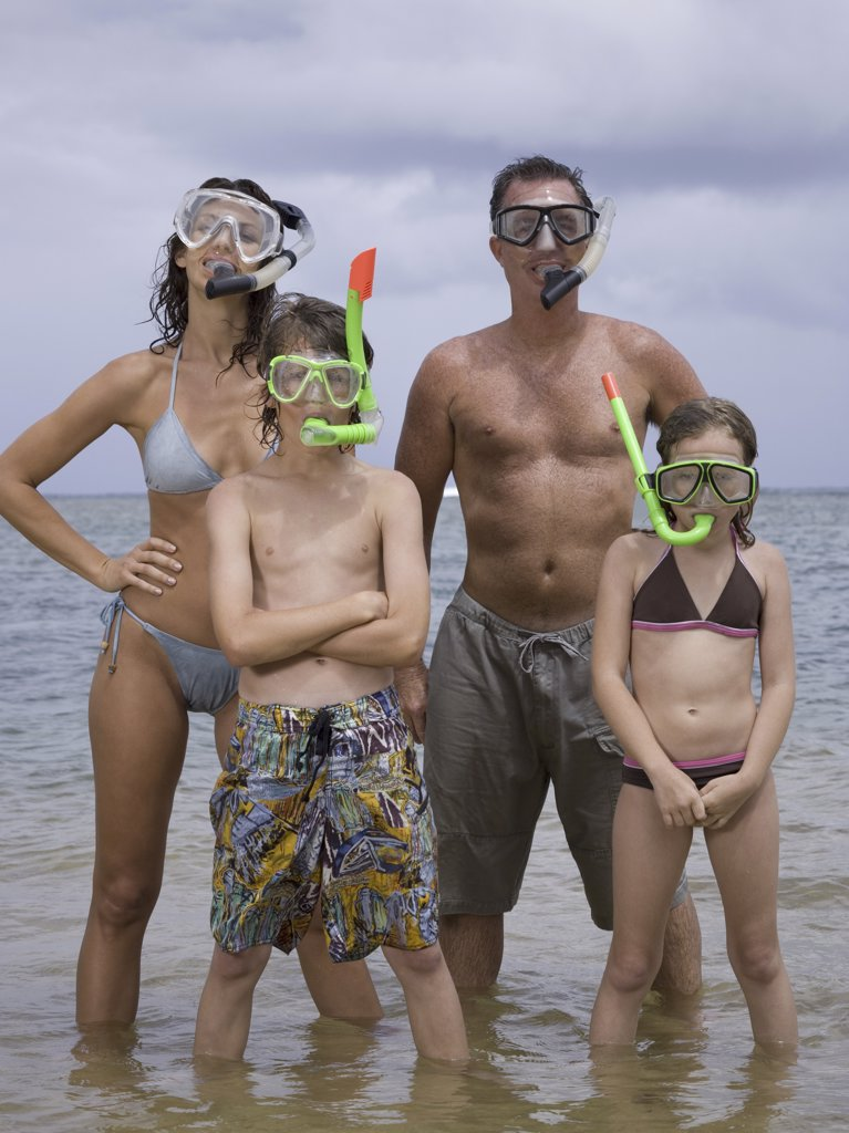 Stock Photo: 1660R-10528 Portrait of a family wearing scuba masks and snorkels