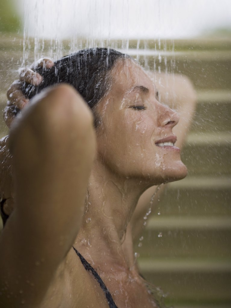 Stock Photo: 1660R-10537 Close-up of an adult woman having a bath