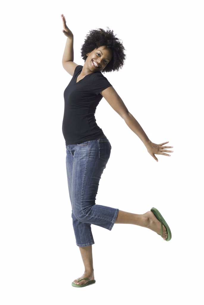 Stock Photo: 1660R-10997 Portrait of a young woman standing on one leg