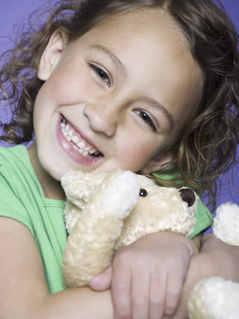 Portrait of a girl hugging a teddy bear : Stock Photo
