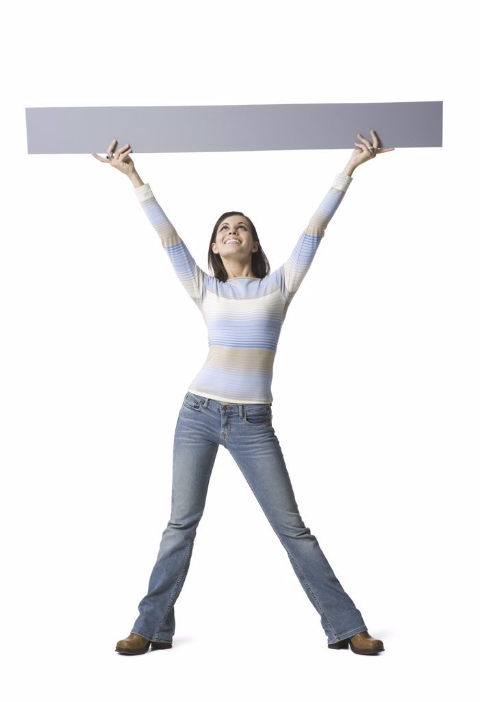 Young woman lifting up a placard : Stock Photo