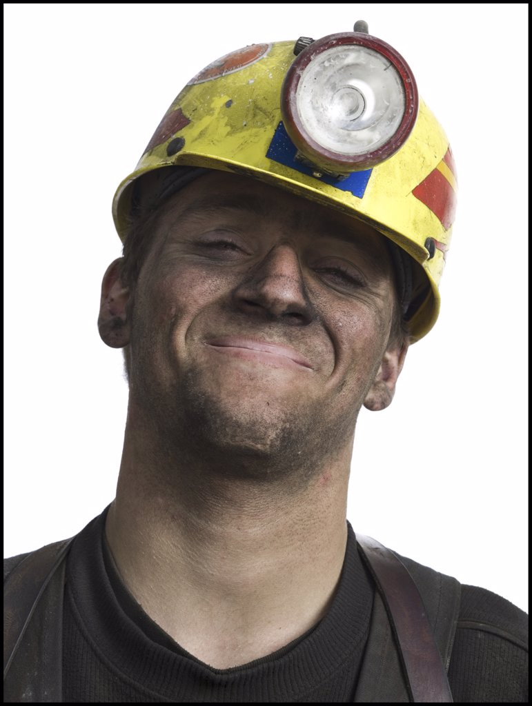 Stock Photo: 1660R-1125 Portrait of a miner wearing a hardhat with a headlamp
